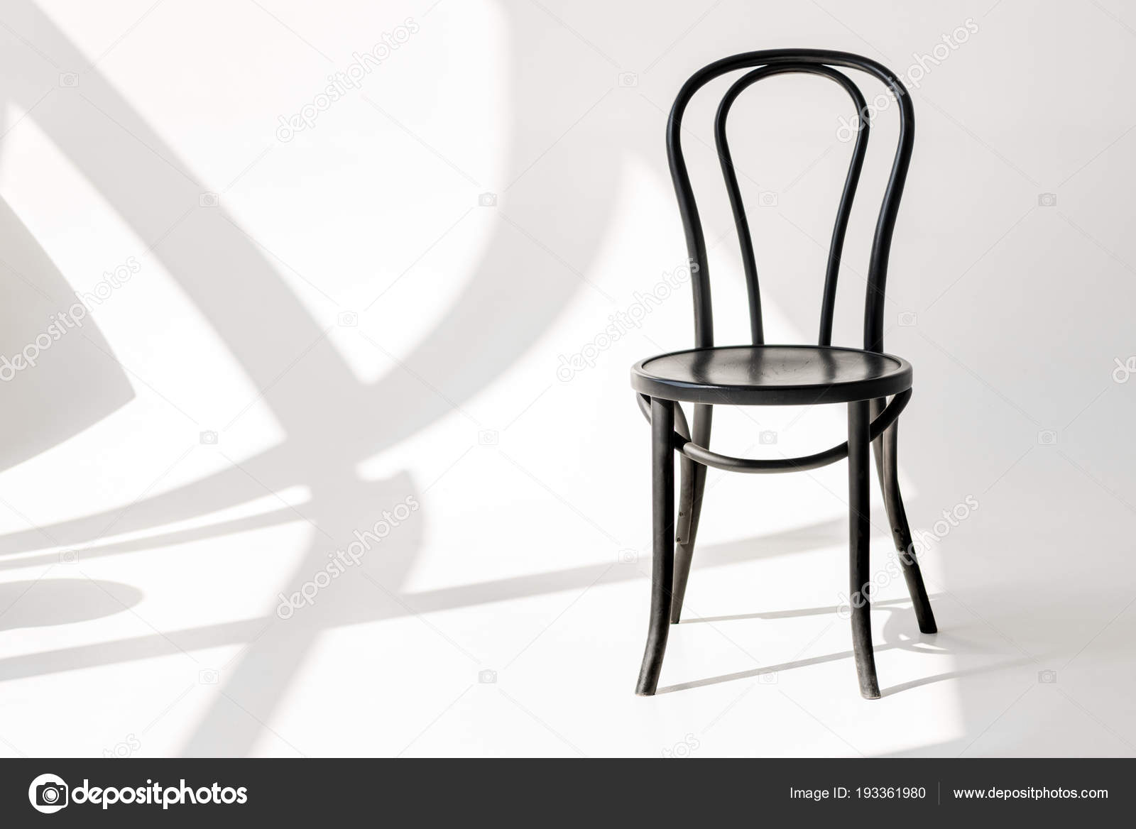 Close Up View Of Black Wooden Chair On Grey Backdrop With Shadows U2014 Photo  By ViktoriaSapata