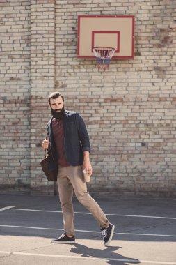 Man posing on basketball yard