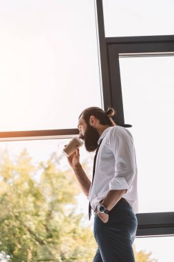 bearded businessman drinking coffee