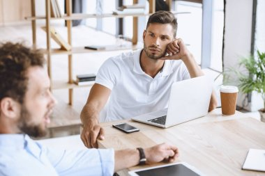 businessman on meeting with coworkers