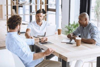 multiethnic businessmen at meeting