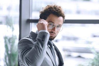 confident businessman in eyeglasses