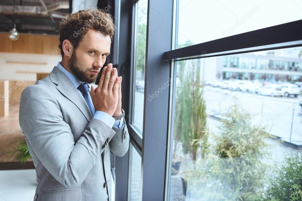 caucasian businessman praying