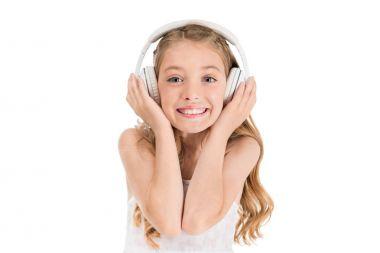 Smiling caucasian little girl listening music in headphones isolated on white stock vector