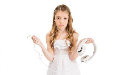 Upset child with headphones