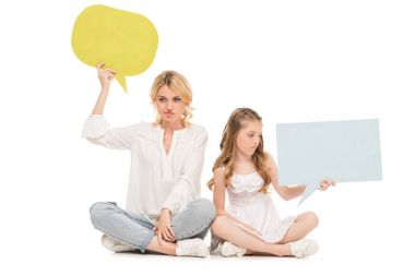 Upset mother and preteen daughter holding colorful blank cards isolated on white stock vector