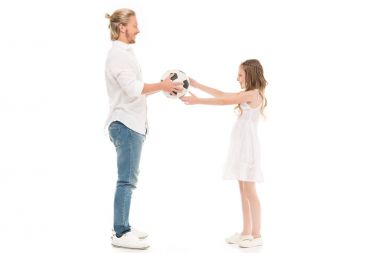 father and daughter with soccer ball