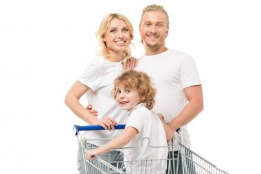 family with son in shopping cart