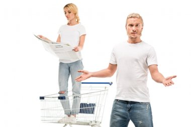 woman with newspaper in shopping cart