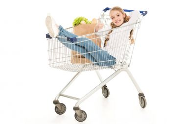 Happy little girl sitting in shopping cart and showing thumb up isolated on white stock vector