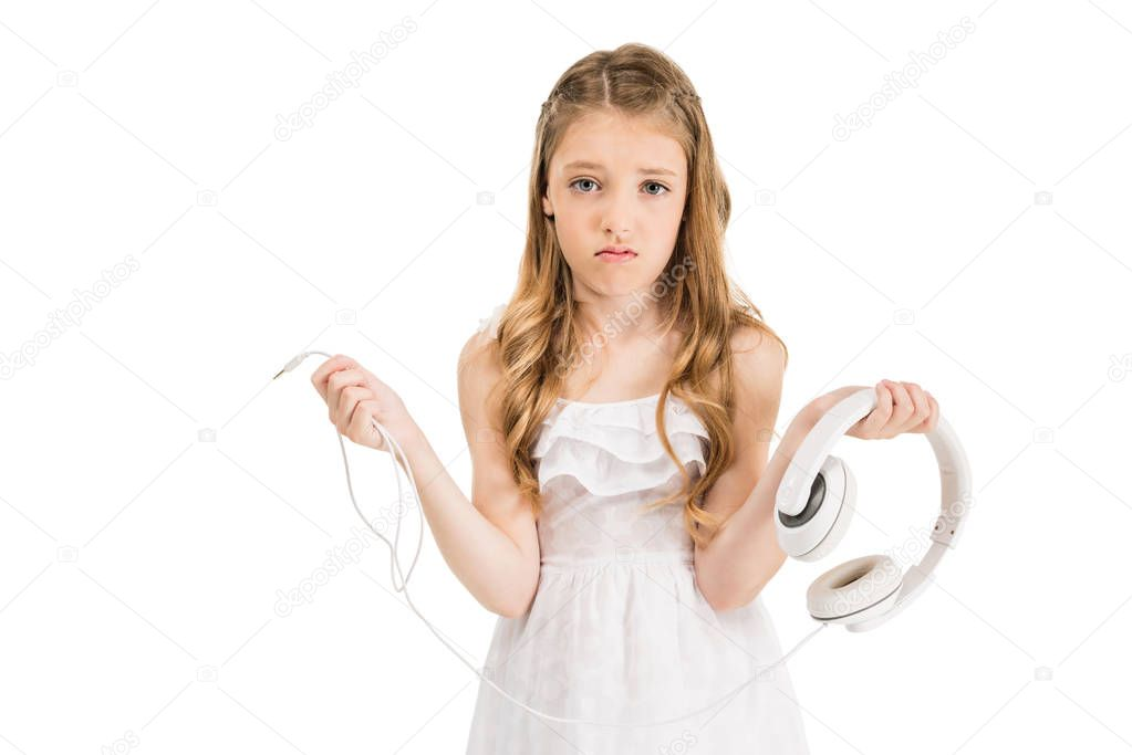 upset child with headphones