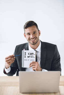 businessman pointing at notebook