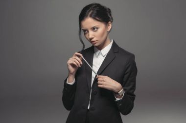 businesswoman holding pencil