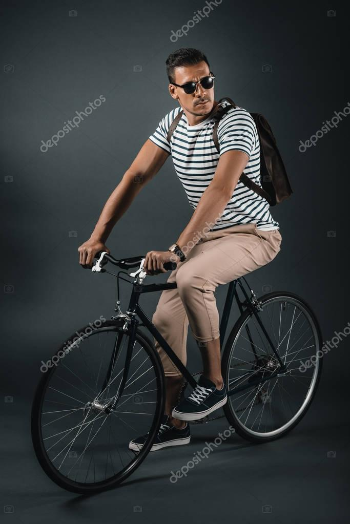man sitting on bicycle
