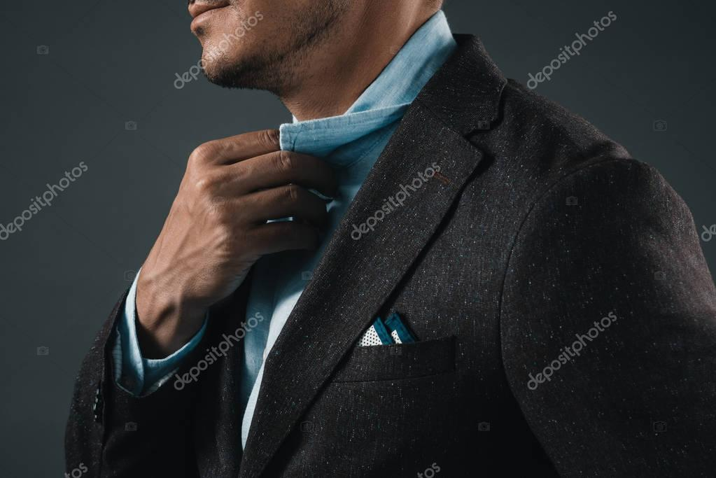 2 man holding shirt collar