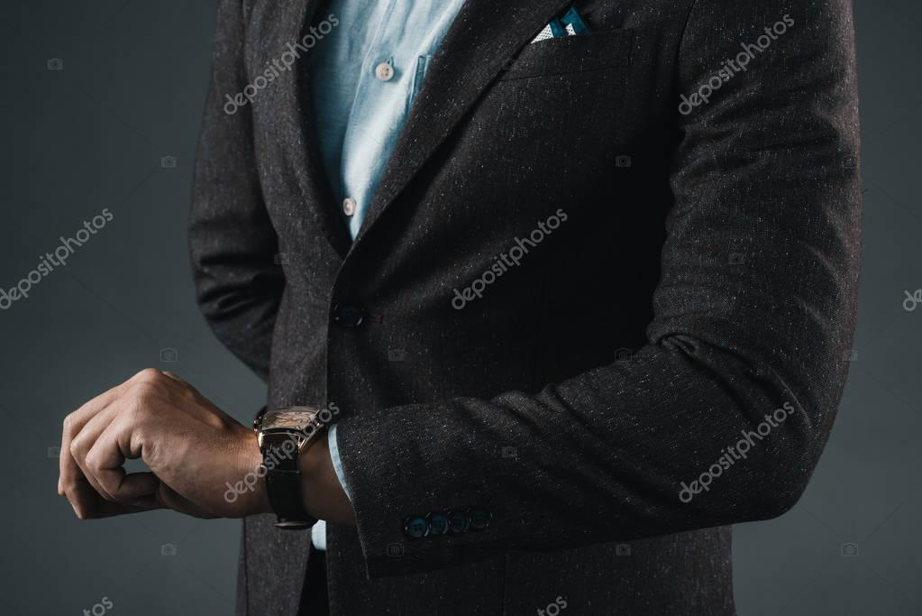 stylish man looking at hand watches
