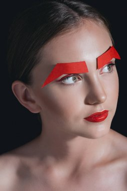 beautiful woman with paper eyebrows