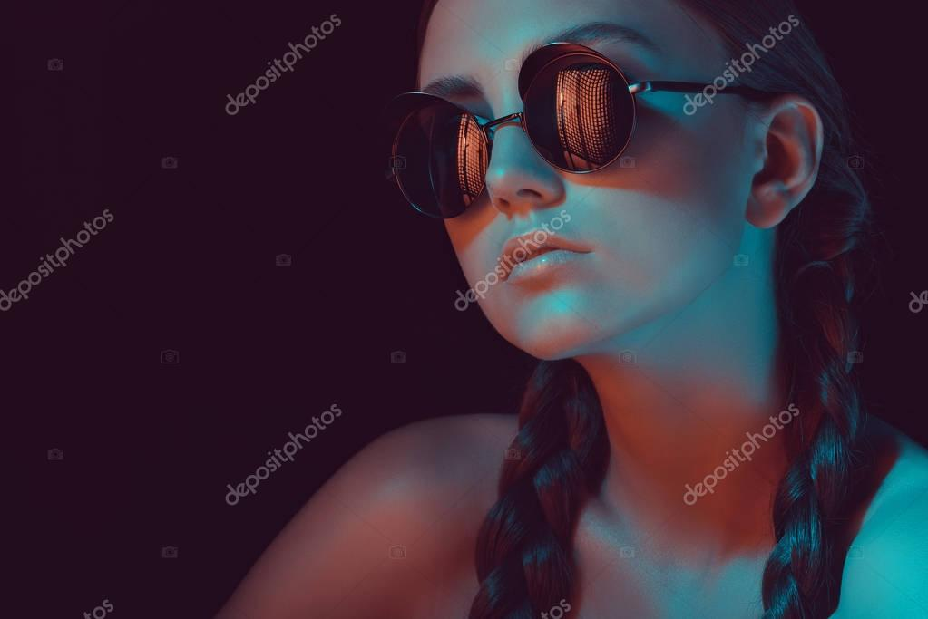 Portrait of young stylish woman with braids in fashionable sunglasses stock vector