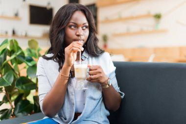 Woman with coffee latte