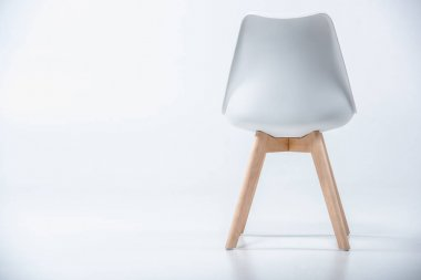 chair with white top and wooden legs