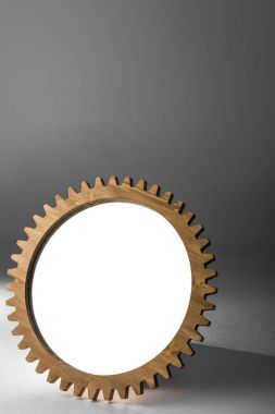 mirror framed by wooden cogwheel