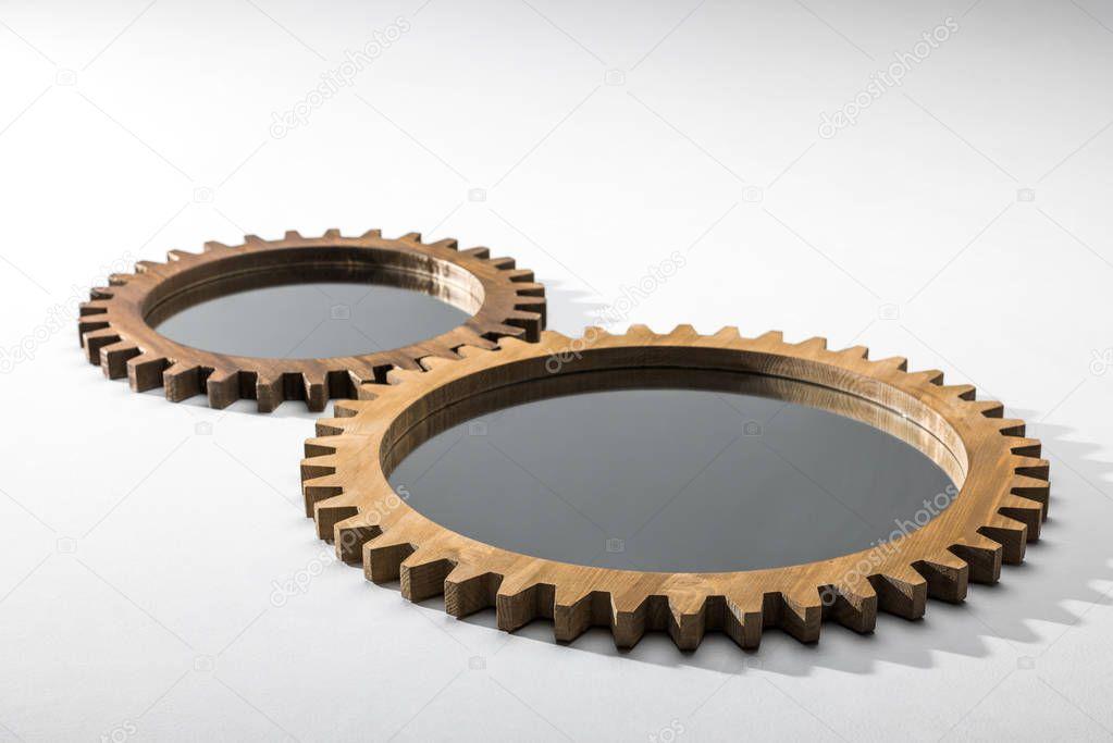 Two wooden cogwheels