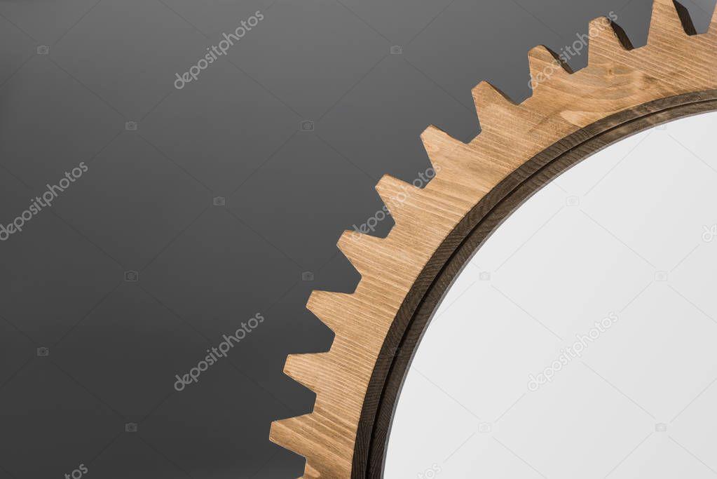 mirror framed by wooden cogwheel
