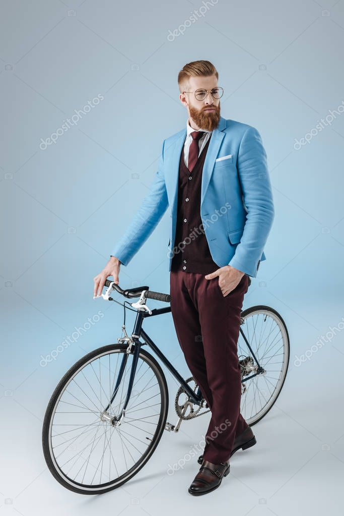 stylish man with bicycle