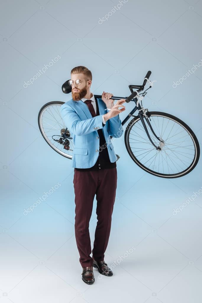 stylish man holding bicycle