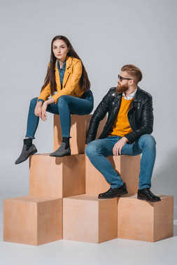Stylish couple in leather jackets and jeans