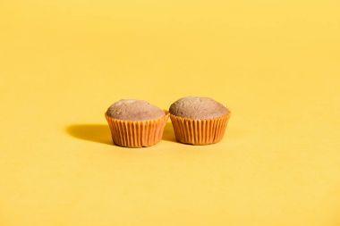 homemade muffins on yellow