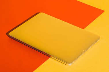 laptop on yellow and red