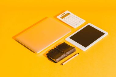 digital devices on yellow