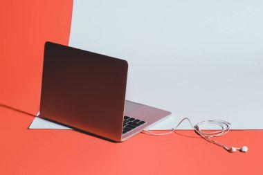 Laptop and earphones