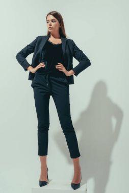 girl posing in suit