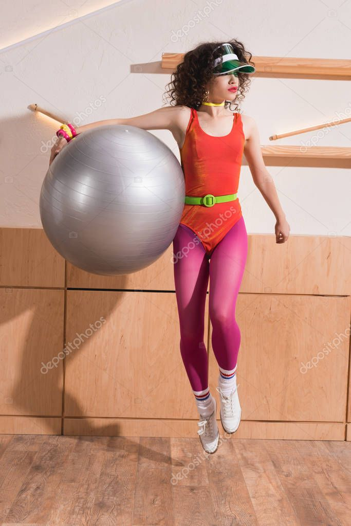 stylish woman with fitness ball