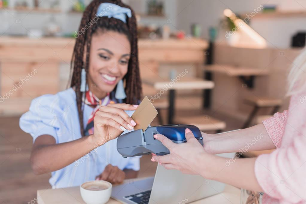 african american woman paying with card