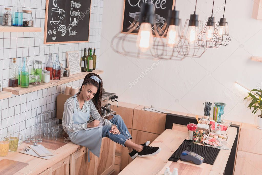 barista sitting on counter