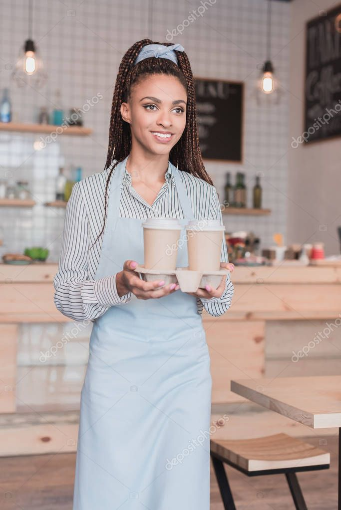 barista holding holder with disposable cups