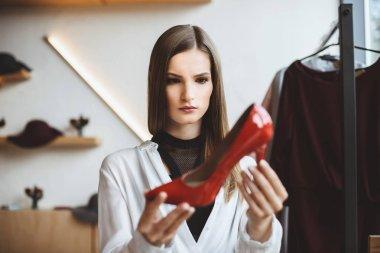 woman choosing elegant heels