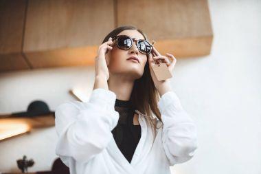 elegant woman in sunglasses