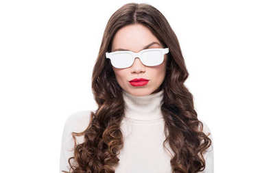 woman in white sunglasses raising brow