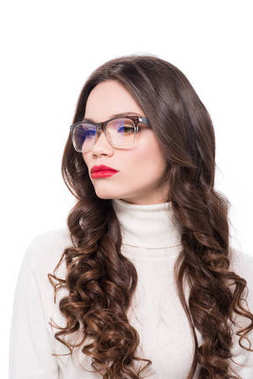 Young attractive woman with red lipstick wearing trendy glasses and looking aside, isolated on white stock vector