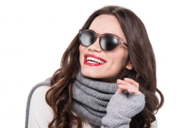 Young smiling woman in scarf and arm warmers, wearing trendy sunglasses, isolated on white stock vector
