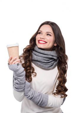 Cheerful woman holding paper cup