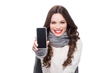Smiling woman showing smartphone