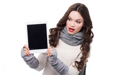 Excited woman showing digital tablet