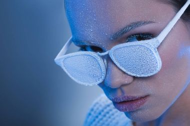 woman in sunglasses covered in frost