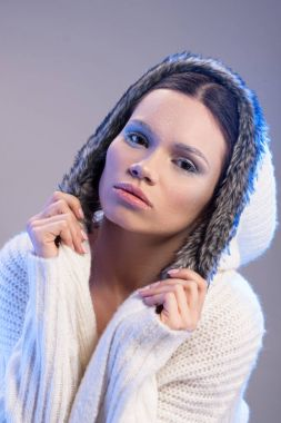 woman in hooded sweater
