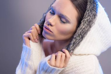 Young woman in hooded sweater